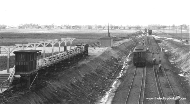 We previously ran another version of this same image on a post in 2016, but I thought it was worth getting a second copy. This one has somewhat less contrast, so you get a better view of the platform. The original caption was: The CRT Westchester branch at Roosevelt Road, circa 1929-1930. Service along this line opened in 1926, and when the line was extended, local officials insisted that tracks not cross Roosevelt at grade, thereby necessitating this grade separation project. The platform at left was later moved into the open cut, although the original station house was retained. Service to Mannheim began in 1930. The line was abandoned in 1951. We are looking north.