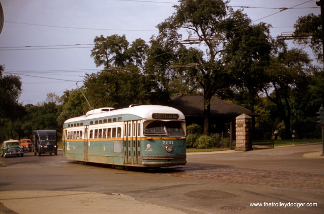 CTA 7211, still in its original paint scheme, heads south at Clark Street and Irving Park Road in September 1957, near the entrance to Graceland Cemetery. A version of this image, taken from a duplicate slide, appears on page 164 of B-146, where it was incorrectly attributed to Charles L. Tauscher. (Robert Heinlein Photo)