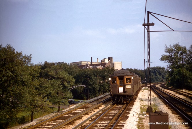A three car train of northbound CTA woods on the Evanston Express in August 1957, just a few short months before the last of the woods was retired from regular service. Since the train is using third rail, and there are four tracks, this is somewhere south of Evanston.